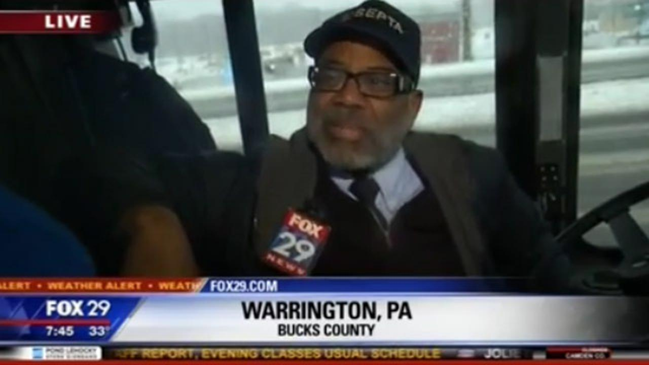 Bus Driver Loses Mind During Live Interview When People Try To Sneak Onto Bus