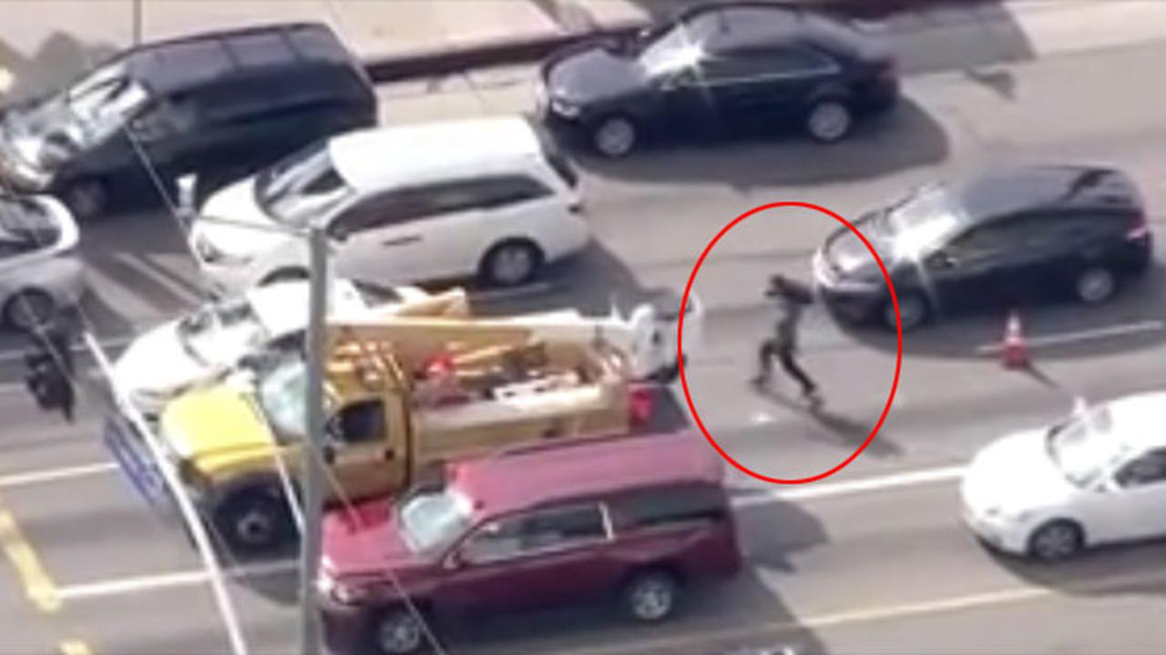 Insane Camerman Sprints To Armed Suspect's Vehicle During Police Chase