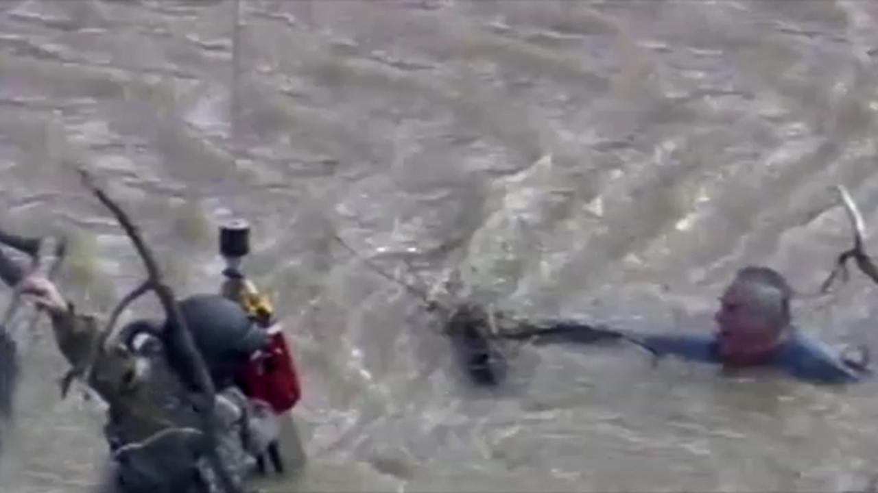 Badass Helicopter Rescue Of Man Who Nearly Died In Flood Waters