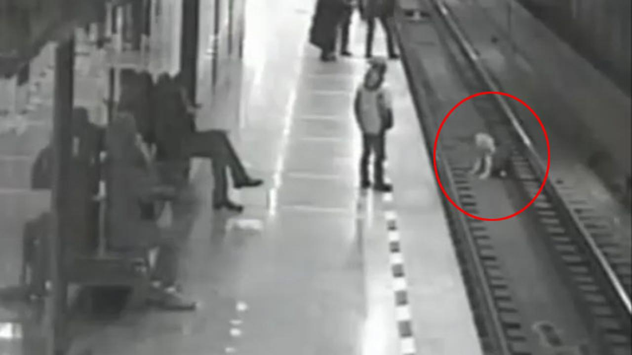Heroic Man Rescues Kid Who Fell Onto Train Tracks While Texting
