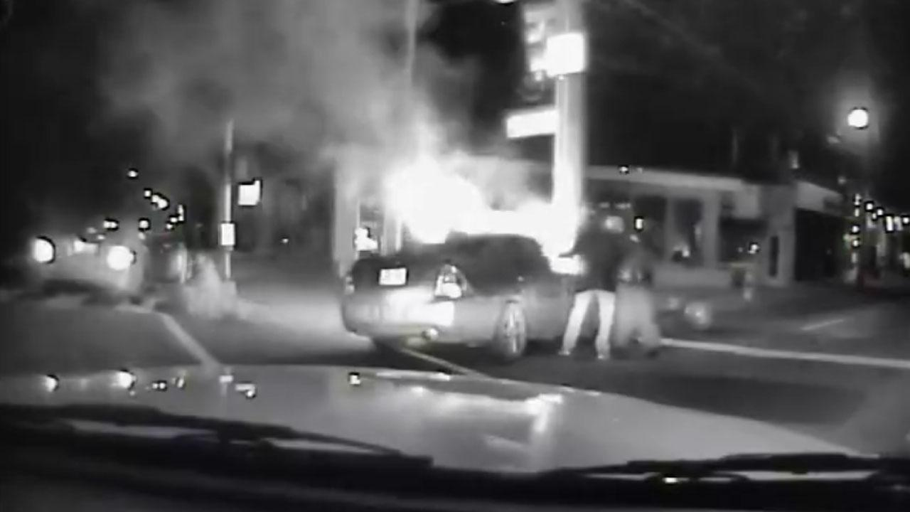Good Samaritan, Police Officer Rescue Two Individuals From Fiery Car Wreck