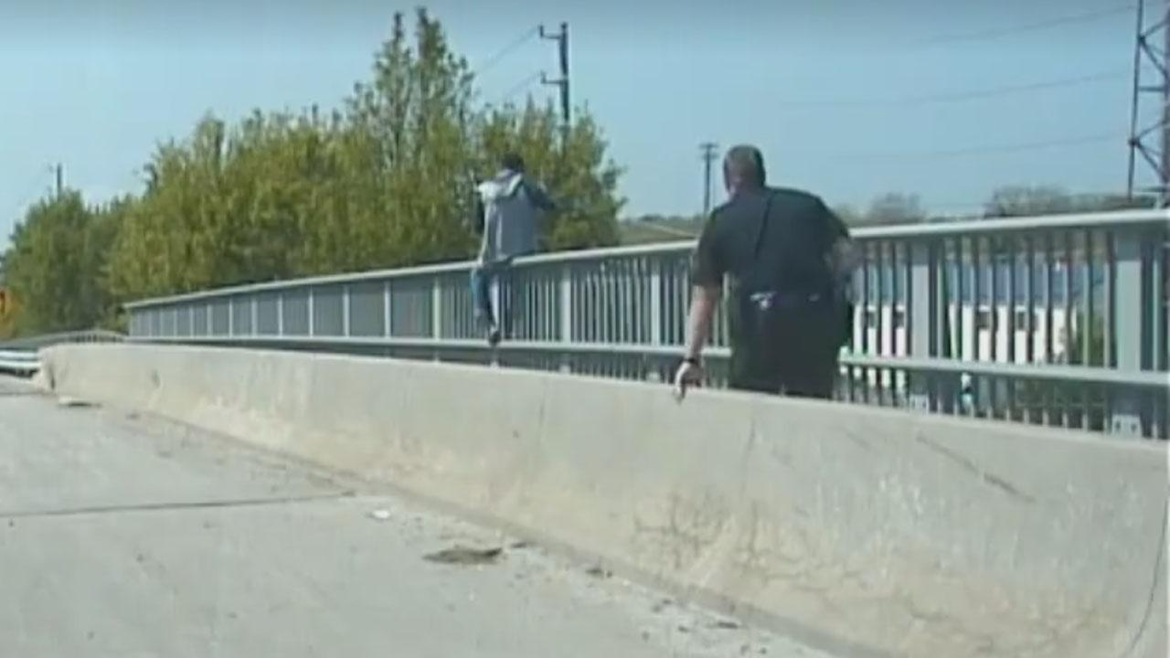 Brave Police Officer Stops Suicidal Man From Jumping Off Bridge