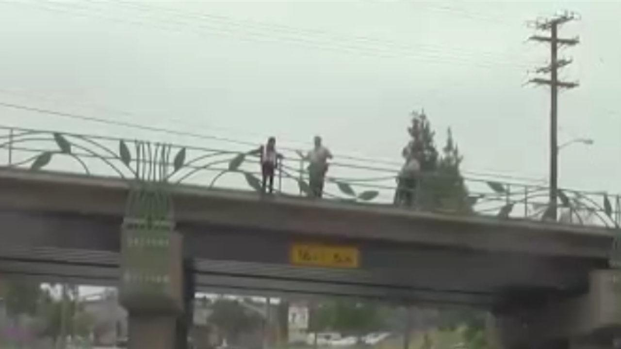 Tense Moment Heroic Cops Stop Suicidal Woman From Jumping Off A Bridge