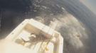 Swordfish Gets In Boat, Fishermen Get Out Of Boat
