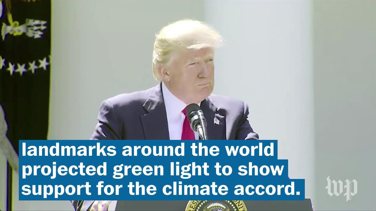 International landmarks light up green for Paris accord
