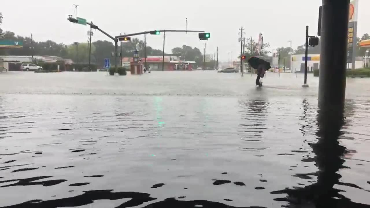 People Wading Through Streets In Jacinto City