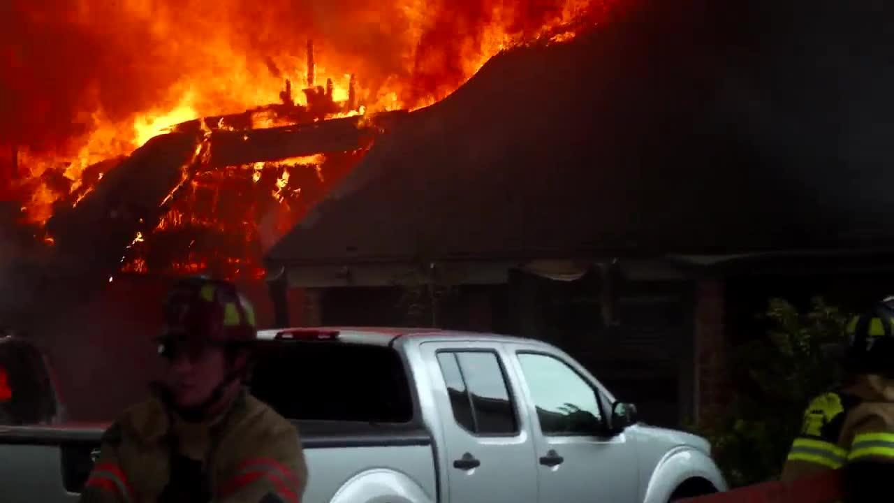 Firefighters Rescue Family In Burning House